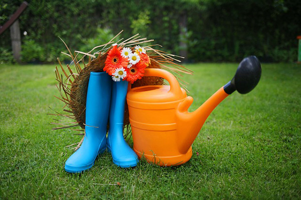 farm hat, boots, flowers and the best watering can